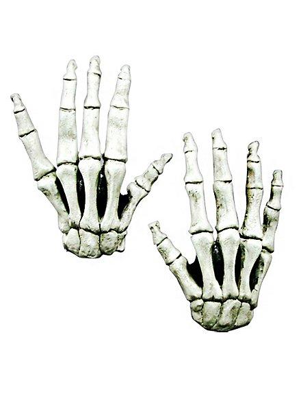 Mains de squelette à longs doigts blanches en latex