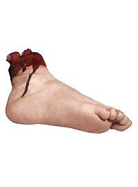 Abgehackter blutiger Fuß