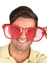 Énormes lunettes rouges