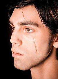 Fluide à cicatrices au collodion