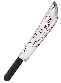 Machette en plastique avec du faux sang