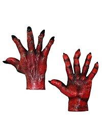 Mains de démon rouges
