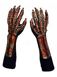 Mains de squelette sanglantes