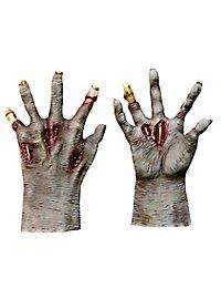 Mains de zombie foncées